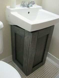 Pics On The Project Lady Make a fake bathroom cabinet to hide ugly pipes