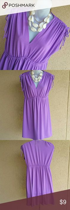 Summer Dress or Beach Cover-Up Summery light dress with empire waist and shirred ties sleeves. Can be worn as a dress or a beach cover-up. Very comfortable. In good condition. Faded Glory Dresses