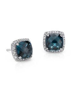 Vivid in color, these london blue topaz earrings are surrounded by a sparkling halo of micropavé white topaz gemstones.