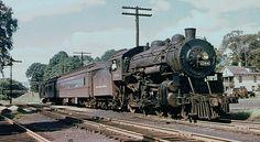 New York Central F12 class 4-6-0 Ten Wheeler steam locomotive # 1244, is seen hauling a passenger train at Yorktown Heights, New York, 07-20-1951