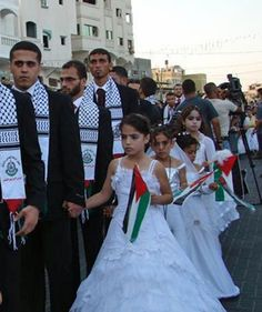 Muslim Child Brides (waving Palestinian flags) and Hamas Arab Militant husbands in a group marriage, Palestine.