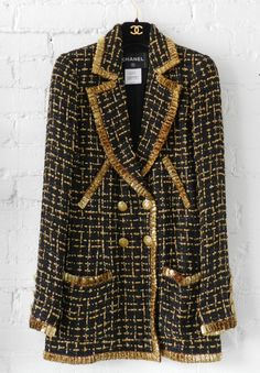 Black and amber tweed jacket with metallic gold trim and CC enamel buttons   Karl Lagerfeld for Chanel   France, Resort 2007 Collection