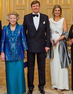 March 2014. Dinner Nationaal Comité Inhuldiging. Princess Beatrix, king Willem Alexander and queen Maxima. She wears a dress of designer J. Mendel.