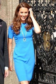 Kate Middleton in Blue    In This Photo: Kate Middleton  Catherine, The Duchess of Cambridge, wears an Olympic Ring style necklace as she visits the National Portrait Gallery in London. Kate, who is acting as art patron and Olympic ambassador ahead of the 2012 Olympics, also wore a blue dress and black heels. by commmom