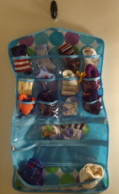 Use a hanging jewelry organizer to keep your babies' socks together!  You can hang it on the wall in the nursery or in baby's closet to keep it out of the way.