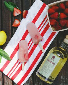Strawberry RHUBARB Lemonade Boozy Popsicles - Makes 10 pops  Ingredients 1 ½ cups Raspberry Lemonade 1 cup fresh Strawberries 1 cup Sugar 1 cup Water 5 fresh basil leaves ¼ cup RHUBARB Tea