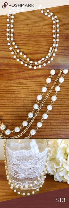 Triple chain pearl and gold necklace Triple chain pearl and gold necklace (pearls are not real). Excellent condition! Forever 21 Jewelry Necklaces