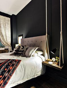 Chic black walls with a boho edge, patterned throw and rustic bedside table swing. www.daniellenatalie.com