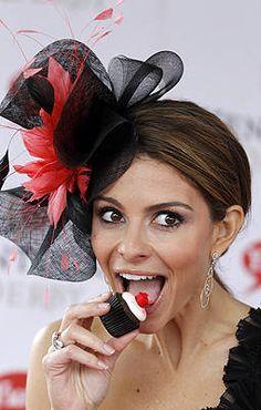 TV host Maria Menounos enjoys a snack before the Kentucky Derby.
