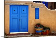 New Mexican adobe wall & blue door