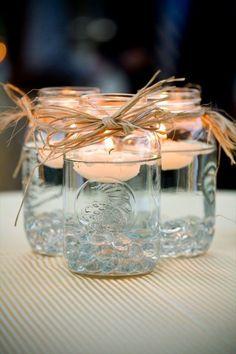 Mason jars with floating tea lights.