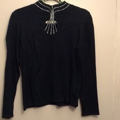 Black rhinestone bling sweater/blouse Black rhinestone keyhole front rhinestone sweater also trimmed around collar.  3 small button neck closure in back.  Very pretty.  Looks good under suit or wear with  skirt or pants. ALL STONES ARE IN TACT!!!  No flaws!  Great condition! Sweaters Cowl & Turtlenecks