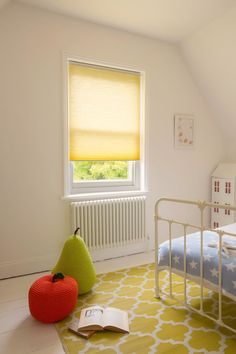 Create  luminous optimism and happiness in a child's room with yellow toned Duette® Architella® honeycomb shades with LiteRise® cordless lifting system designed for enhanced child safety.  ♦ Hunter Douglas window treatments