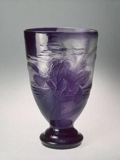 Vase decorated with Irises, Workshop of Emile Galle, France, 1898 -- Two-layered glass: clear and lilac; mold-blown, etched, engraved & hand-polished.  Hermitage Museum