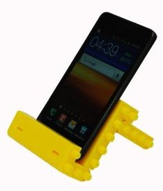 DIY Building Blocks Cell Phone Stand in Yellow by JEKCA. $12.95. Jekca Do-It-Yourself DIY Cell Phone HolderEverybody loves building blocks! Now you can use them to build your own cell phone holder with this kit. Very cool and very different than your usual boring cell phone stand. It even has hinges so you can collapse it for easy travel! Don't ever let go of the kid inside of you. WATCH PRODUCT VIDEO The kit includes everything you need:specially-designed bui...
