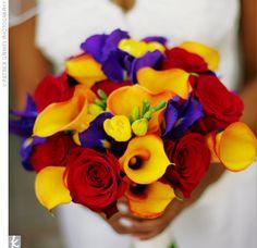 I love the bright mango calla lilies and deep purple irises.