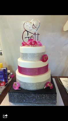 4 tier wedding cake Black, white, silver and hot pink