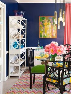 navy dining room with lots of pretty colors <3