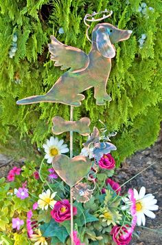 Dachshund metal copper pet memorial garden stake is sitting waiting for you! This adorable angel dog by Garden Copper Art is a fitting tribute to your pampered pet. Handmade in fine artisan detail, this design features a heartwarming image of a Dachshund with angel wings and a halo suspended over its head. Accented with creative artistic copper wire wrapping, heart, butterfly and flowers. This is one of the largest sitting dogs that is applied to a copper rod. Order now to guarantee…