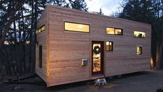 Andrew and Gabriella Morrison of TinyHouseBuild.com : 221sf on a 28′ trailer + 128sf in lofts. By putting the kitchen at one end and the bathroom at the other, they are able to use the full width of the trailer and make them generous. The U-shaped kitchen design is key: the work triangle is just the right size. Needs better safety rails. (More:  tinyhouseblog.com/yourstory/living-without-sacrifice-solutions-top-5-tiny-house-limitations/ )