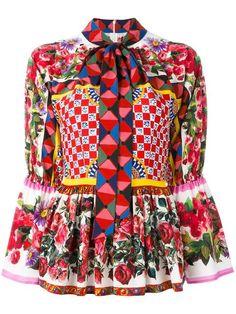 Shop Dolce & Gabbana Mambo print peplum blouse.