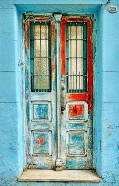 Rustic faded door looks mysterious. Door Entryway, Entrance Doors, Doorway, Cool Doors, Unique Doors, Knobs And Knockers, Door Knobs, Doors Galore, Vintage Doors