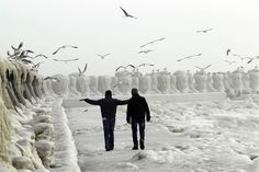People stroll past the frozen shore in the Black Sea harbour of Constanta, 155 miles km) east of Bucharest, Romania, February Visit Romania, Big Chill, Beauty Around The World, Pictures Images, Photos, Black Sea, Winter Landscape, Winter Fun