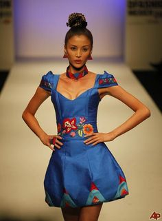 Young Mexican Model in a lovely little dress at Mercedes Benz  Fashion Show in Mexico City 2012.