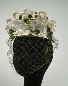 A gorgeous Bes-Ben 1940s swan hat (made using felt, silk floss, coated paper, and silk velvet trim). #vintage #1940s #hats #swans #fashion