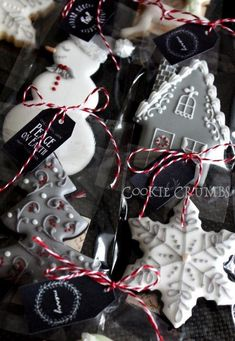 Black, Gray & White Snowflake, Tree, Snowman and Snow-covered House Christmas Cookies