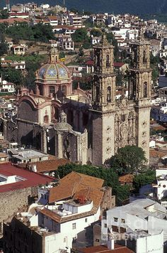 ✮ Aerial view of the Churrigueresque (Mexican Baroque) Santa Prisca Church and the Spanish colonial town of Taxco, Guerrero, Mexico