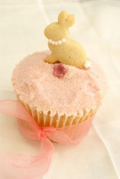 Mini bunny cookie on a lemon cupcake