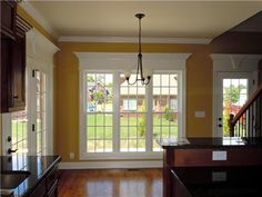 I love the HUGE molding around the windows and doors. What a great way to add vintage character to a newer home.