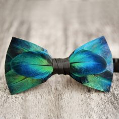 Peacock feather bow tie, by @brackishbowties  #feather #featherbowtie #peacock…