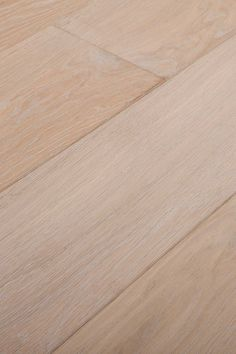 Calco White. Don't be fooled by this light almost buttery white. It's soft, but it has an ever-present underlying strength. Chapel Parket wooden flooring.