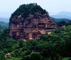 The Maijishan Grottoes (simplified Chinese: 麦积山石窟; traditional Chinese: 麥積山石窟; pinyin: Màijīshān Shíkū) are a series of 194 caves cut in the side of the hill of Majishan in Tianshui, Gansu Province, northwest China. This example of rock cut architecture contains over 7,200 Buddhist sculptures and over 1,000 square meters of murals. Construction began in the Later Qin era (384-417 CE).