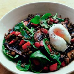 Gently cooked lentils and veg with wilted spinach topped with a poached egg - a great veggie main course.