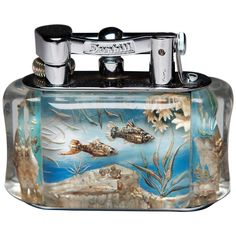 Dunhill Aquarium Table Lighter    From a unique collection of antique and modern desk accessories at https://www.1stdibs.com/furniture/decorative-objects/desk-accessories/