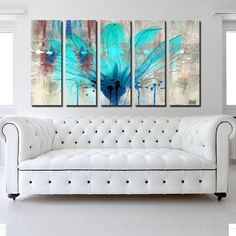 'Painted Petals LII' melts its primary colors of blue and teal into an abiding background of grey flux and primal crimson. Contemporary in its composition, this floral abstract is gallery wrapped on canvas, rendering an apparition of a flower, the scent of a phantom.