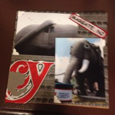 Lucy the Elephant, Margate NJ, Front & Behind; Page 3: This a 8 by 8 scrapbook page featuring elephant/safari themed paper and cut-out of word Lucy from gift bag.