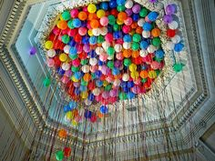 Colored balloons in high ceiling