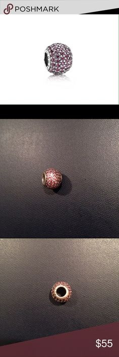 PANDORA Red Pave lights charm Authentic. Even though the description says red, the CZ stones are a dark pink color. The pink pave lights charm has light pink CZ stones. So I think that's why they call it red to differentiate the two. But the stones are totally pink. I have two of these! (See other identical listing) Pandora Jewelry