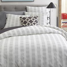 Streaks of gray layer over a neutral background for bedding that puts you right to sleep.