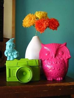 Take old trinkets and items from the thrift store, spray paint them bright colors and use them to spice up a table or bookshelf