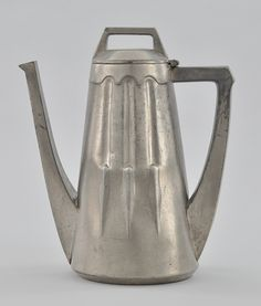 A  coffee pot by Peter Behrns(1868-1940) of Germany, with a secessionist feel. The pot is made of pewter but originally nickel.  Aspire Auctions, (2017). Decorative Arts.[online]Available at: https://www.aspireauctions.com/#!/catalog/217/839/lot/32626[Accessed 15 May 2017].