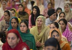 Image: People attend a prayer service at the Sikh Temple of Wisconsin in Oak Creek, Wis.