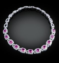 """34.5 carat sapphire and diamond necklace. This spectacular necklace is alive with vibrant color played against the brilliant white of diamonds and platinum. Links of white diamonds weighing approximately 15.00 carats frame 11 stunning pink corundum stones weighing approximately 34.50 carats in a classic display of elegant design. 151/2"""" length."""
