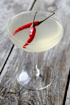 The Killer B  A play on the classic gin-honey-lemon cocktail the bee's knees, The Killer B (from Miami Beach restaurant Khong River House) swaps honey with a fiery Thai bird chile-white peppercorn syrup for a drink with a complex kick.     Photo: Helen Rosner