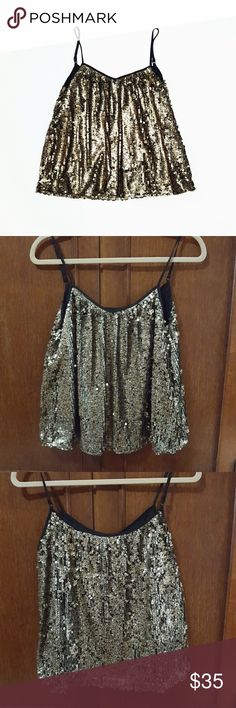 """Aryn K Gold Black Sequin Cami Flowy Top Very pretty. Gold sequins have black splotches on them (see close-up pics) and are a light shade of gold, not yellowish. Adjustable straps. Lined. Fabric content in 5th pic. Great with black leggings or skinny jeans and heels. Great condition.  Armpit to armpit approx 17 1/4"""" when flat, width at bottom 25"""", length when straps are adjusted as shown 23 1/4"""". Aryn K Tops Camisoles"""