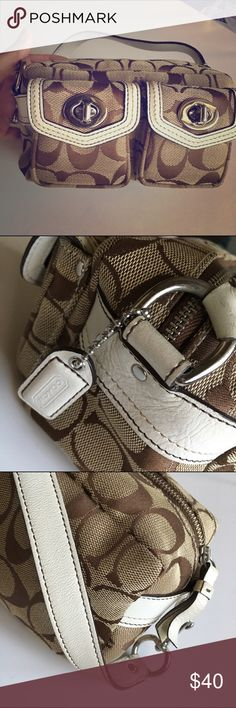 """Coach - Mini hand bag This adorable signature print handbag is in very good condition. Would make a perfect """"first designer bag"""" for the young diva in your life. Fairly roomy despite its small appearance. Coach Bags Mini Bags"""